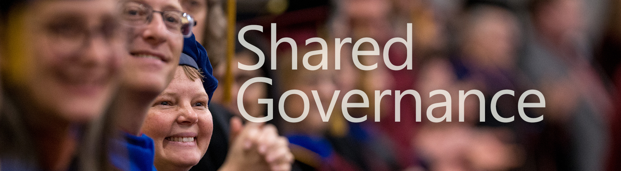 Shared Governance - image faculty clapping at Commencement